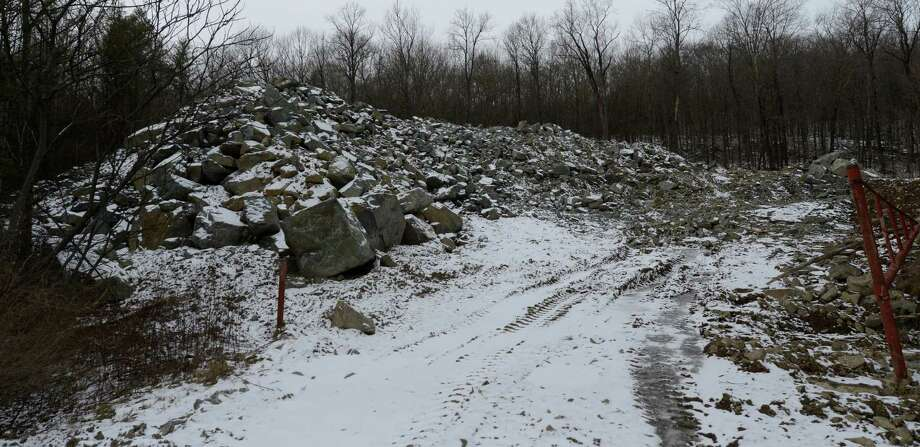 The residue of the blasting on the hillside of Route 4 in Fort Ann, N.Y.  lies in an area just east of the rock slide location Dec 26, 2012. (Skip Dickstein/Times Union) Photo: SKIP DICKSTEIN / 00020572A