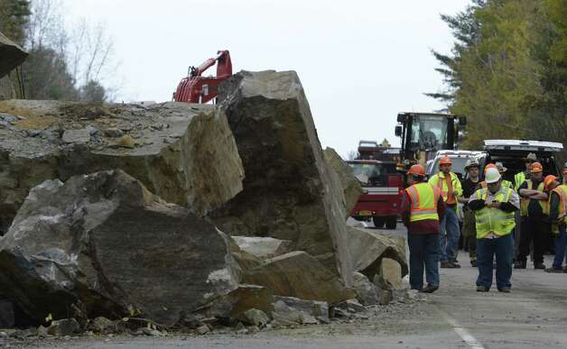 A large rock slide has closed State Route 4 north of Fort Ann, N.Y. Oct. 15, 2012.  Numerous pieces of heavy excavation equipment have been brought to the scene to determine if there were any vehicles caught under the rocks.  The scene is being controlled by the New York State DOT and the New York State Police.  Fort Ann Fire and EMS have responded to the scene.  (Skip Dickstein/Times Union) Photo: SKIP DICKSTEIN