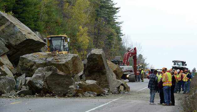 A large rock slide has closed State Route 4 north of Fort Ann, N.Y. October 15, 2012.  Numerous pieces of heavy excavation equipment have been brought to the scene to determine if there were any vehicles caught under the rocks.  The scene is being controlled by the New York State DOT and the New York State Police.  Fort Ann Fire and EMS have responded to the scene.  (Skip Dickstein/Times Union) Photo: SKIP DICKSTEIN