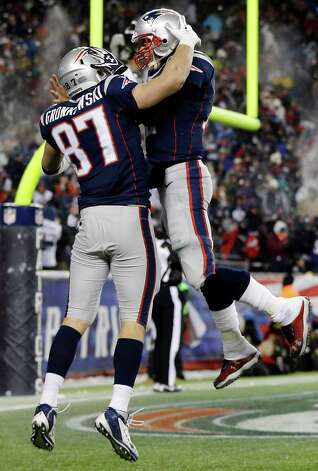 New England Patriots quarterback Tom Brady, right, celebrates his touchdown pass to tight end Rob Gronkowski (87) during the fourth quarter of an NFL football game against the Miami Dolphins in Foxborough, Mass., Sunday, Dec. 30, 2012. (AP Photo/Elise Amendola) Photo: Elise Amendola
