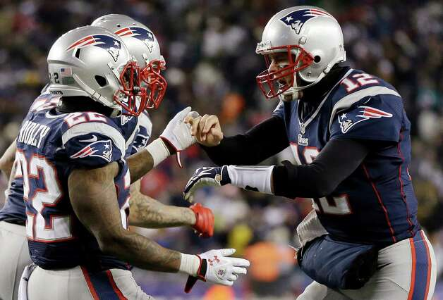 New England Patriots quarterback Tom Brady (12) congratulates running back Stevan Ridley (22) after Ridley's second rushing touchdown against the Miami Dolphins during the second quarter of an NFL football game in Foxborough, Mass., Sunday, Dec. 30, 2012. (AP Photo/Elise Amendola) Photo: Elise Amendola