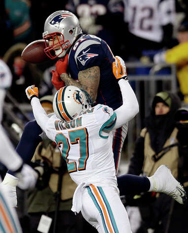Miami Dolphins cornerback Jimmy Wilson (27) breaks up a pass intended for New England Patriots tight end Aaron Hernandez (81) during the first quarter of an NFL football game in Foxborough, Mass., Sunday, Dec. 30, 2012. (AP Photo/Elise Amendola) Photo: Elise Amendola