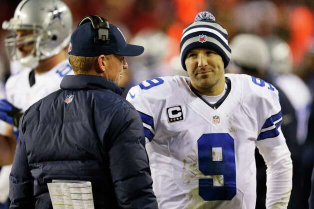 LANDOVER, MD - DECEMBER 30:  Head coach Jason Garrett talks to Tony Romo #9 of the Dallas Cowboys after they failed to convert on a third down against the Washington Redskins at FedExField on December 30, 2012 in Landover, Maryland. Photo: Rob Carr, Getty Images / 2012 Getty Images