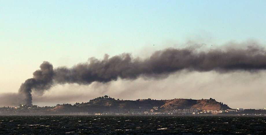 Black smoke spreads from Richmond's Chevron refinery after an explosion set off a fire Aug. 6. Photo: Lance Iversen, The Chronicle