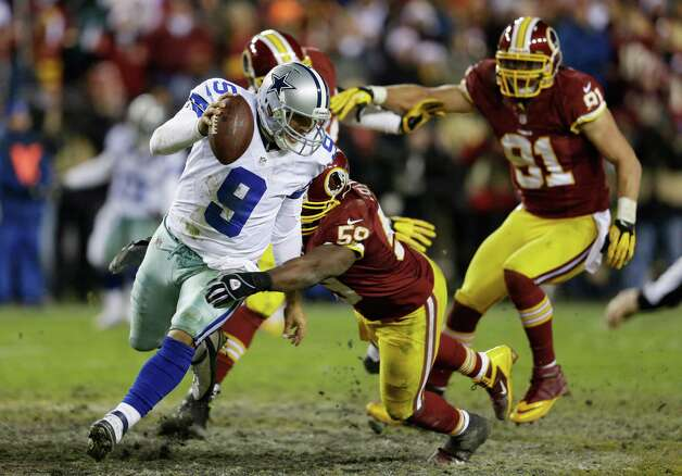LANDOVER, MD - DECEMBER 30:   Tony Romo #9 of the Dallas Cowboys tries to avoid the tackle of  London Fletcher #59 of the Washington Redskins in the fourth quarter at FedExField on December 30, 2012 in Landover, Maryland. Photo: Rob Carr, Getty Images / 2012 Getty Images