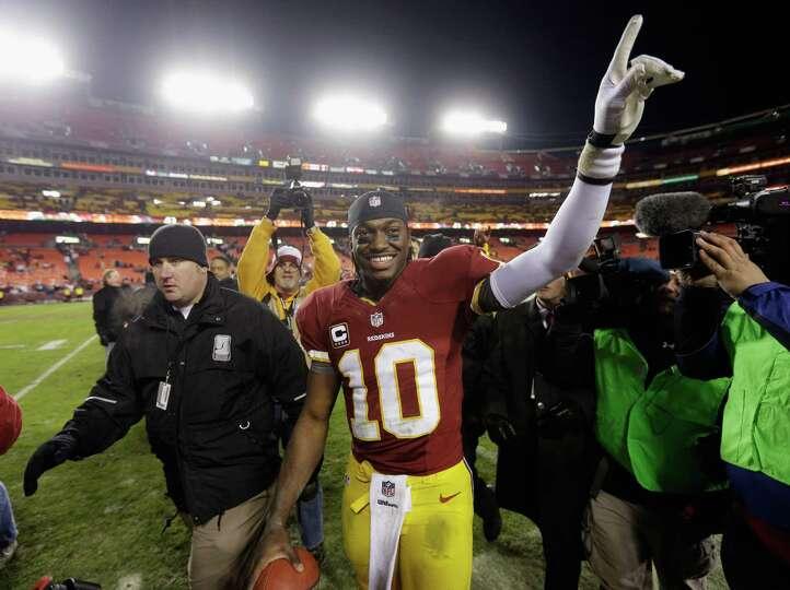 LANDOVER, MD - DECEMBER 30: Quarterback Robert Griffin III #10 of the Washington Redskins celebrates