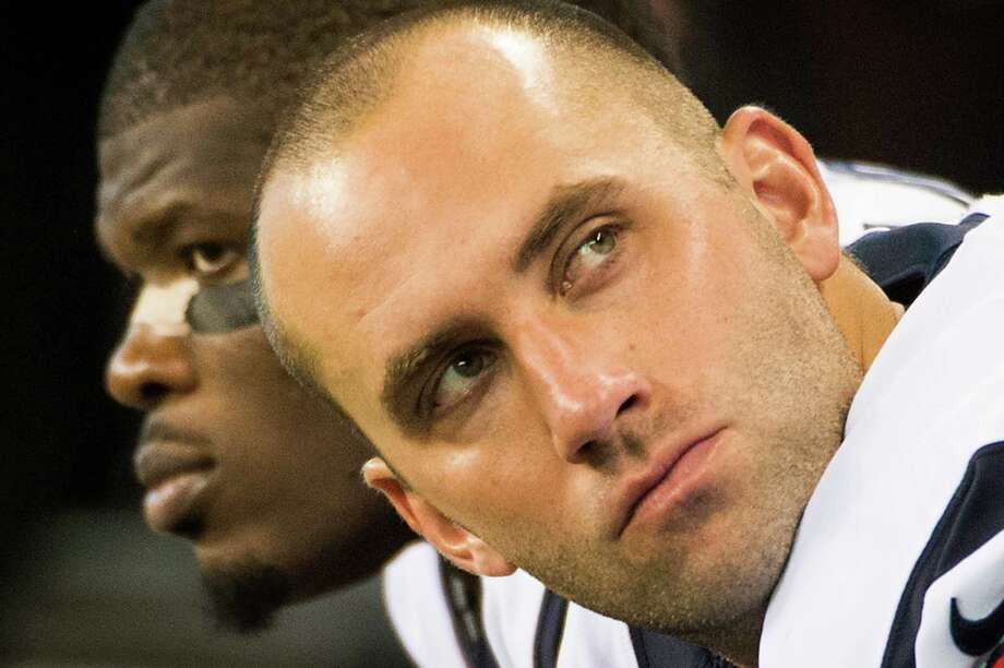 Quarterback Matt Schaub, right, and receiver Andre Johnson ponder the Texans' fate from the bench as the final minute of the loss ticks away. Photo: Smiley N. Pool, Staff / © 2012  Houston Chronicle