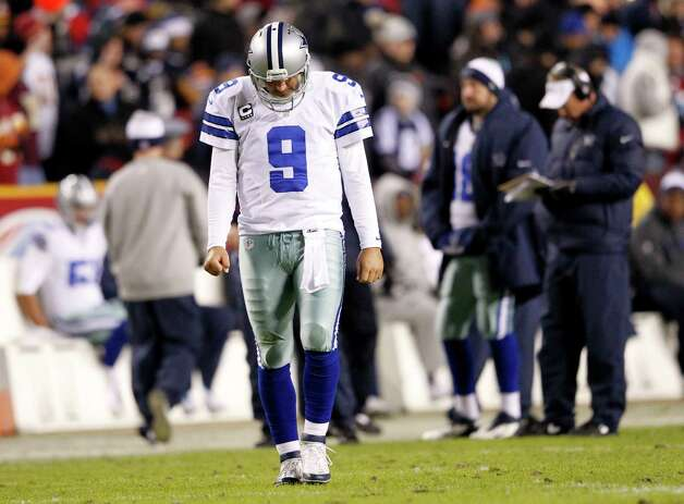 Dallas Cowboys quarterback Tony Romo (9) makes his way back to the field during a break in play as the Washington Redskins beat the Dallas Cowboys 28-18, Sunday, December 30, 2012 in Landover, Maryland. (Vernon Bryant/Dallas Morning News/MCT) Photo: Vernon Bryant, McClatchy-Tribune News Service / Dallas Morning News