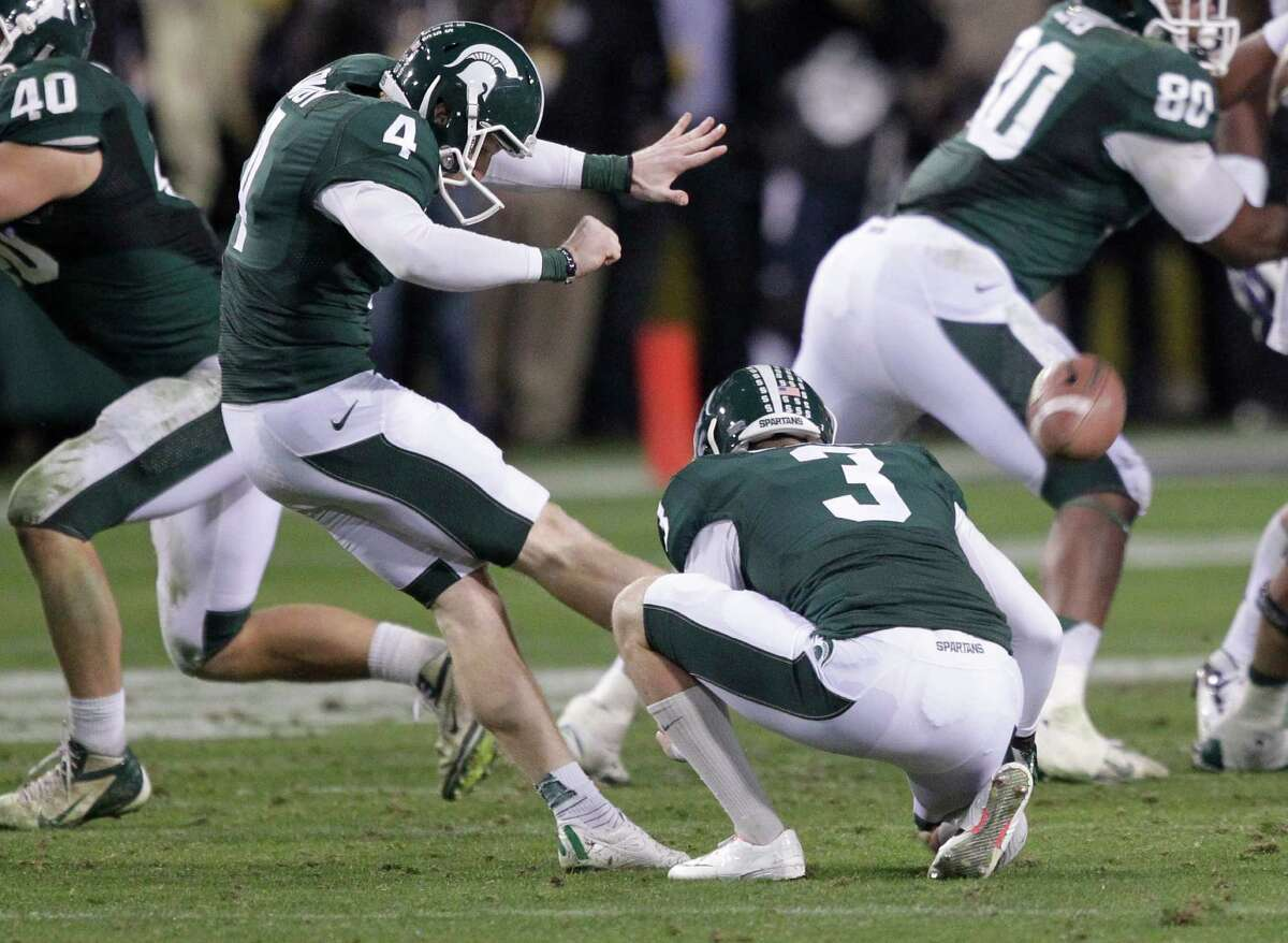 Michigan State's Dan Conroy (4) kicks the go-ahead field goal with 1:01 remaining in Saturday's Buffalo Wild Wings Bowl against TCU.