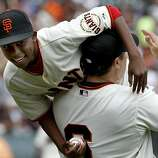 In a fun recreation of the 2002 World Series, JT Snow picked up Darren Baker after a celebration of the 2002 Giants team. The San Francisco Giants defeated the Cincinnati Reds 4-3 Sunday July 1, 2012 at AT&T park.