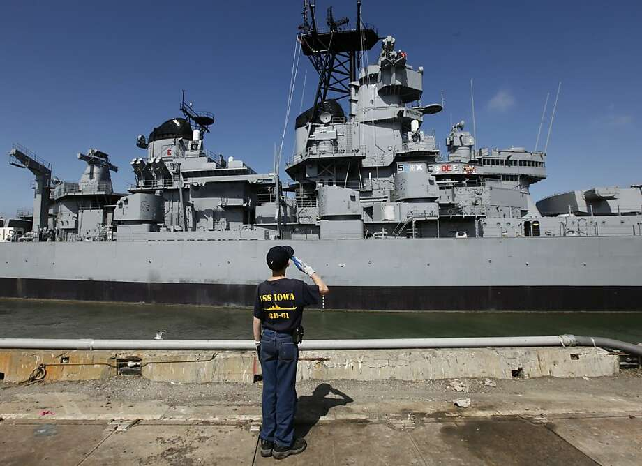 Jonathan Canfield, 12, salutes the battleship Iowa, towed from Richmond  in May to become a floating Los Angeles museum. Jonathan's father served  on the Iowa. Photo: Paul Chinn, Associated Press