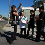 Oakland Community Organizer Katy Nunez-Adler directs students Tearsey Em,  Vu Le and San Chao,  from Fremont High School as they go door to door  to encourage people to vote, Tuesday Nov. 6, 2012, in  Oakland, Calif.