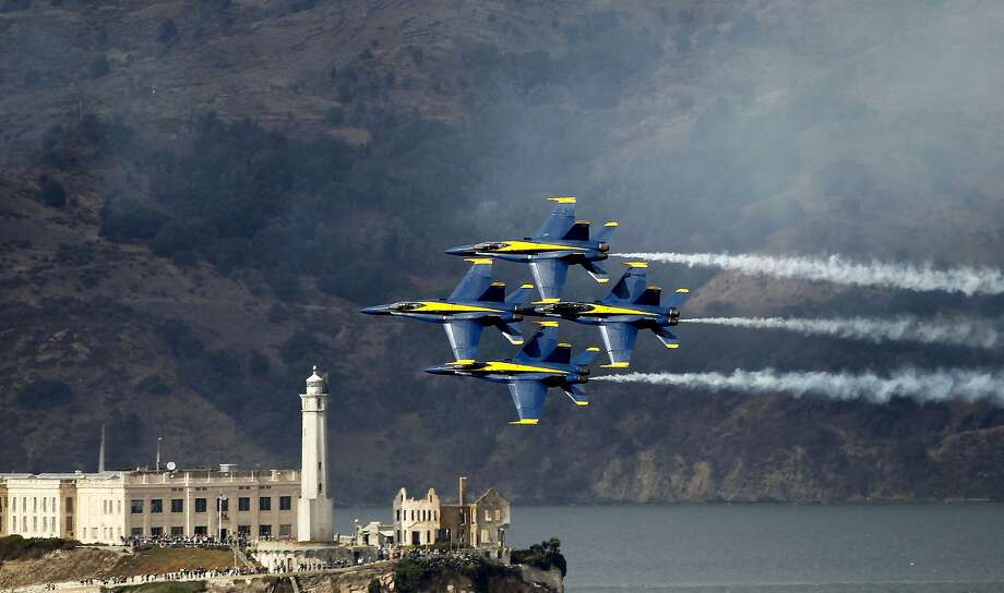 Four members of the Blue Angels pass in front of Alcatraz Island as pilots run through a final rehearsal in the skies above San Francisco, Calif., on Friday October 5, 2012. Photo: Michael Macor, The Chronicle