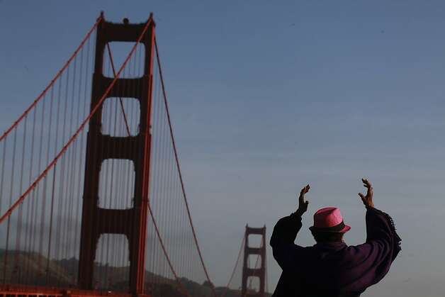 Adriene McBeth, visiting from Washington D.C., practices Tai Chi at the south end of the Golden Gate Bridge on May 1, 2012 in San Francisco, Calif. Photo: Mike Kepka, The Chronicle