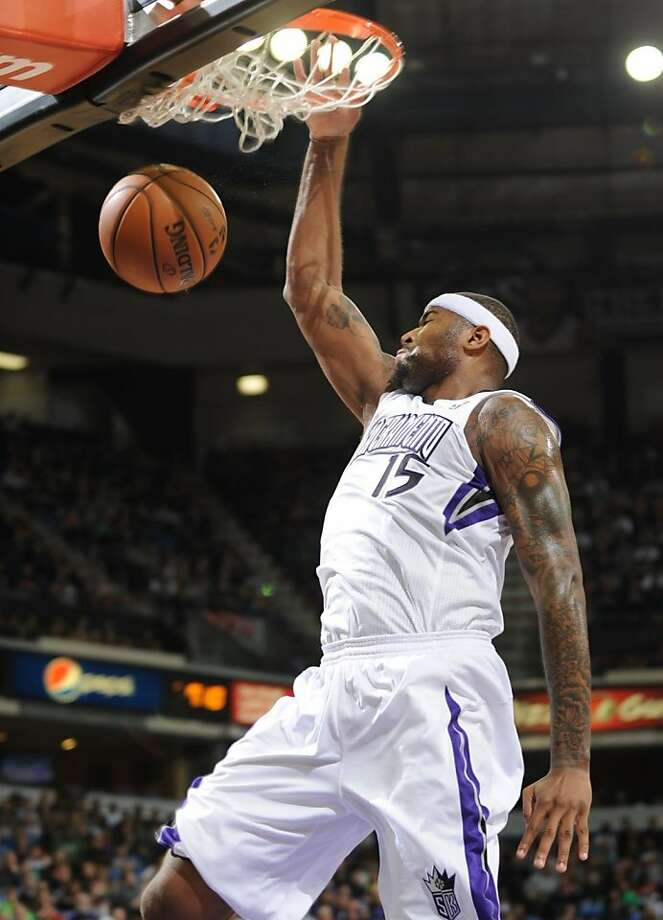 DeMarcus Cousins had his first career triple- double with 12 points, 10 rebounds and 10 assists. Photo: Hector Amezcua, Associated Press