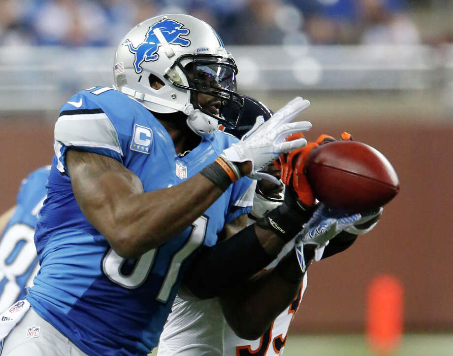 Detroit's Calvin Johnson caught five passes but fell short of becoming the first player to have 2,000 receiving yards in a season. Photo: Duane Burleson, FRE / FR38952 AP