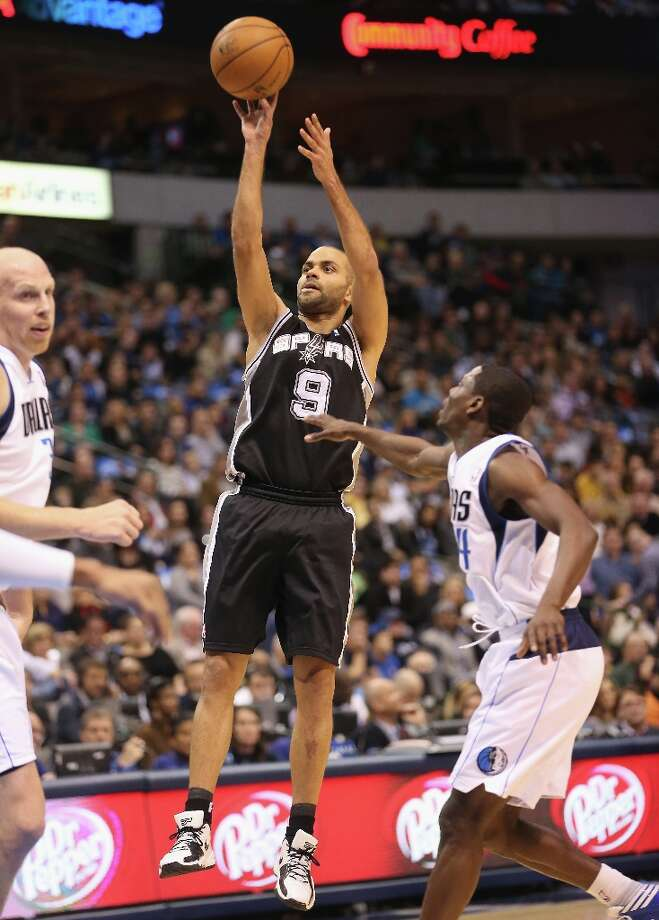 Tony Parker (9) of the Spurs takes a shot against the Mavericks on Sunday in Dallas. Photo: Ronald Martinez, Getty Images / 2012 Getty Images