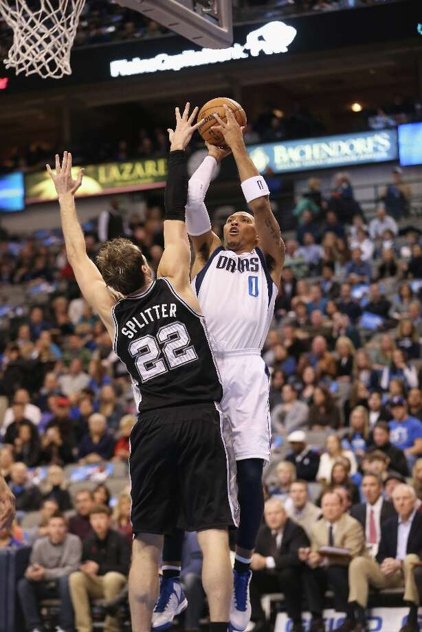 Shawn Marion (0) of the Mavericks takes a shot against Tiago Splitter (22) of the Spurs on Sunday in Dallas. Photo: Ronald Martinez, Getty Images / 2012 Getty Images