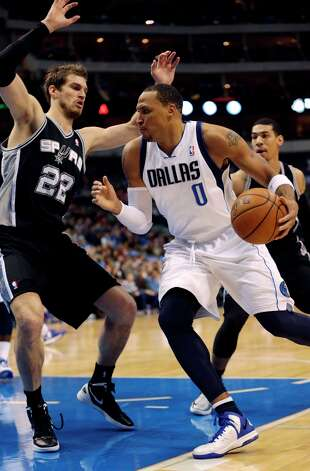 Mavericks forward Shawn Marion (0) drives against Spurs center Tiago Splitter (22) during the first half in Dallas on Sunday, Dec. 30, 2012. Photo: Mike Fuentes, Associated Press / FR103746 AP