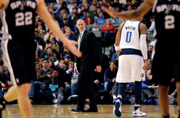 Mavericks coach Rick Carlisle (center) gestures during the first half against the Spurs in Dallas on Sunday, Dec. 30, 2012. Photo: Mike Fuentes, Associated Press / FR103746 AP