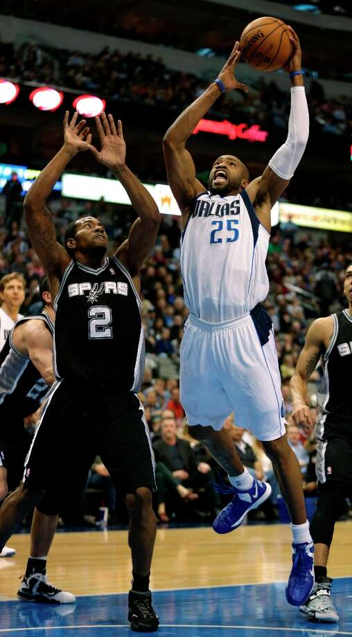 Mavericks forward Vince Carter (25) takes a shot against Spurs forward Kawhi Leonard (2) during the first half in Dallas on Sunday, Dec. 30, 2012. Photo: Mike Fuentes, Associated Press / FR103746 AP