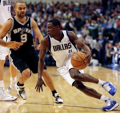 Mavericks guard Darren Collison (4) drives against Spurs guard Tony Parker (9) during the first half in Dallas on Sunday, Dec. 30, 2012. Photo: Mike Fuentes, Associated Press / FR103746 AP
