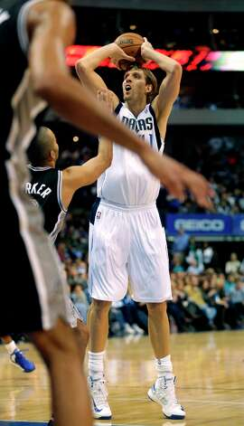 Mavericks forward Dirk Nowitzki (41) takes a shot during the first half against the San Antonio Spurs in Dallas on Sunday, Dec. 30, 2012. Photo: Mike Fuentes, Associated Press / FR103746 AP
