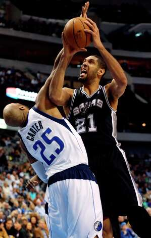 Spurs forward Tim Duncan (21) takes a shot against Mavericks forward Vince Carter (25)  during the second half in Dallas on Sunday, Dec. 30, 2012. San Antonio won 111-86. Photo: Mike Fuentes, Associated Press / FR103746 AP