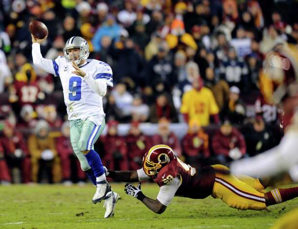 Dallas Cowboys quarterback Tony Romo (9)  throws as he is pressured by Washington Redskins defensive end Jarvis Jenkins (99) during the second half of an NFL football game Sunday, Dec. 30, 2012, in Landover, Md. (AP Photo/Nick Wass) Photo: Nick Wass, Associated Press / FR67404 AP