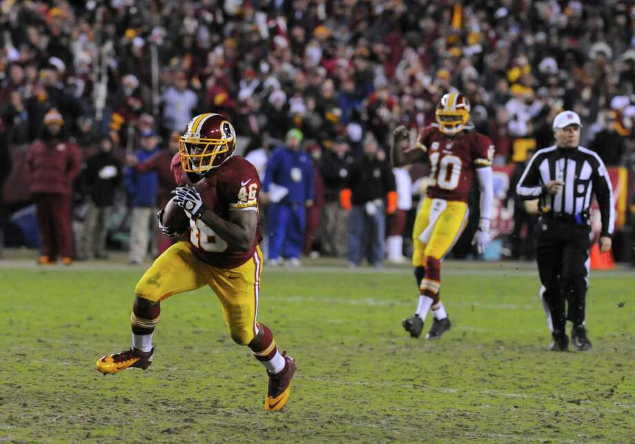 Washington Redskins quarterback Robert Griffin III (10) reacts as Washington Redskins running back Alfred Morris (46) heads for a touchdown during the second half of an NFL football game against the Dallas Cowboys Sunday, Dec. 30, 2012, in Landover, Md. (AP Photo/Richard Lipski) Photo: Richard Lipski, Associated Press / FR170623 AP
