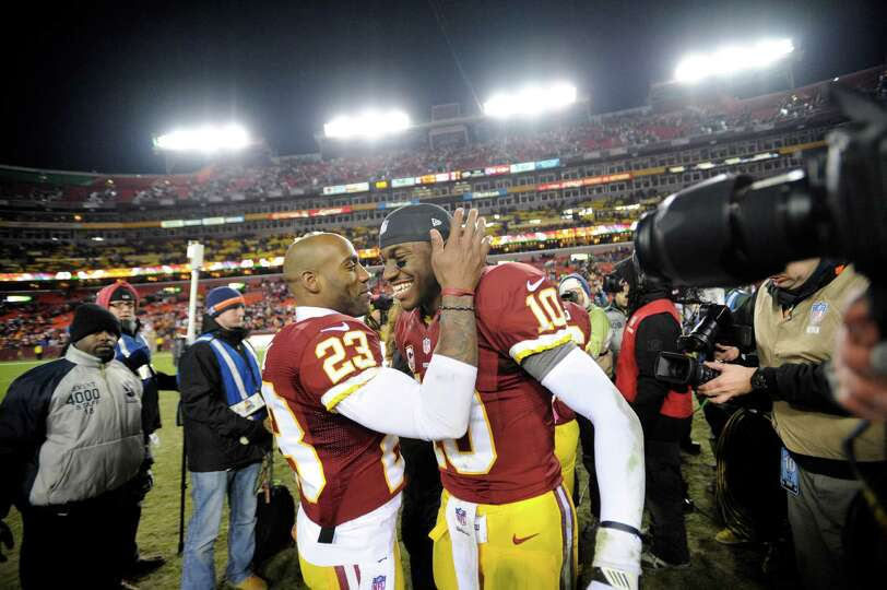 Washington Redskins cornerback DeAngelo Hall (23) celebrates with Washington Redskins quarterback Ro
