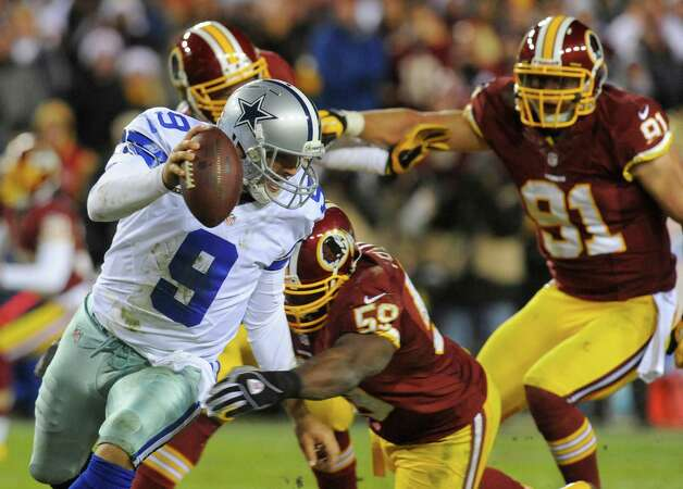 Dallas Cowboys quarterback Tony Romo (9) is sacked by Washington Redskins inside linebacker London Fletcher (59) during the second half of an NFL football game Sunday, Dec. 30, 2012, in Landover, Md. The Redskins won 28-18, securing a playoff berth. (AP Photo/Richard Lipski) Photo: Richard Lipski, Associated Press / FR170623 AP