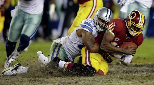 Dallas Cowboys outside linebacker Anthony Spencer (93) sacks Washington Redskins quarterback Robert Griffin III (10) during the second half of an NFL football game Sunday, Dec. 30, 2012, in Landover, Md. The Redskins won 28-18, securing a playoff berth. (AP Photo/Evan Vucci) Photo: Evan Vucci, Associated Press / AP