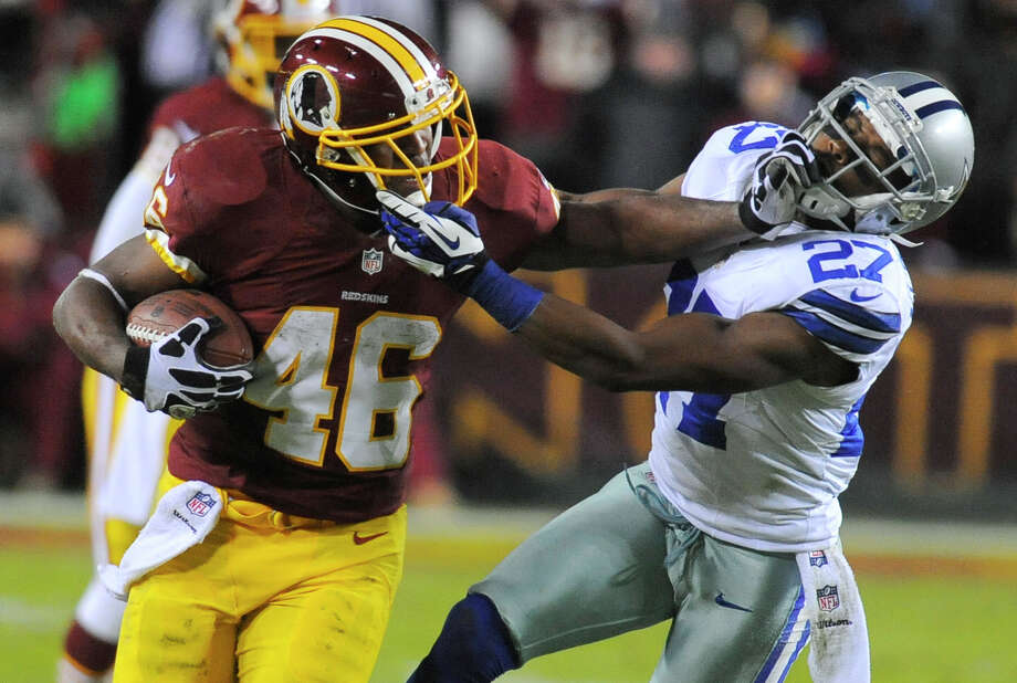Washington Redskins running back Alfred Morris (46) is tackled by Dallas Cowboys strong safety Eric Frampton (27) during the second half of an NFL football game Sunday, Dec. 30, 2012, in Landover, Md. (AP Photo/Richard Lipski) Photo: Richard Lipski, Associated Press / FR170623 AP