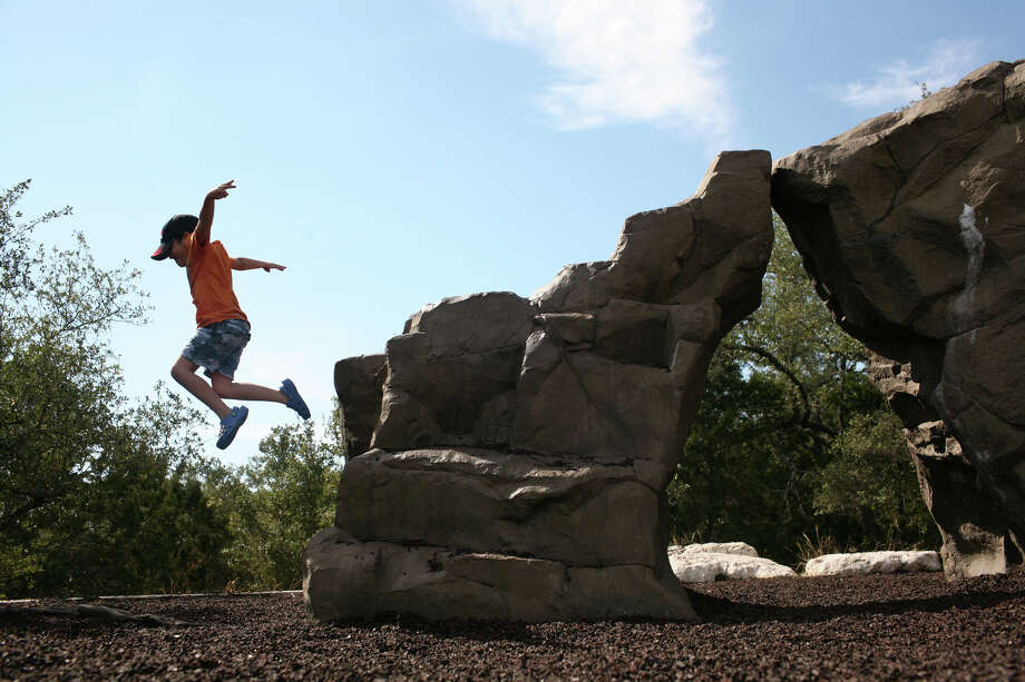 Stone Oak Park: Both the mile-long Stone Oak North Loop and the 1.2-mile linear Stone Oak South Trail are concrete. PHOTO: Baltazar Serna III, 6, plays on a manmade rock at the playground at Stone Oak Park on Nov. 2, 2008. Photo: Lisa Krantz, San Antonio Express-News / lkrantz@express-news.net