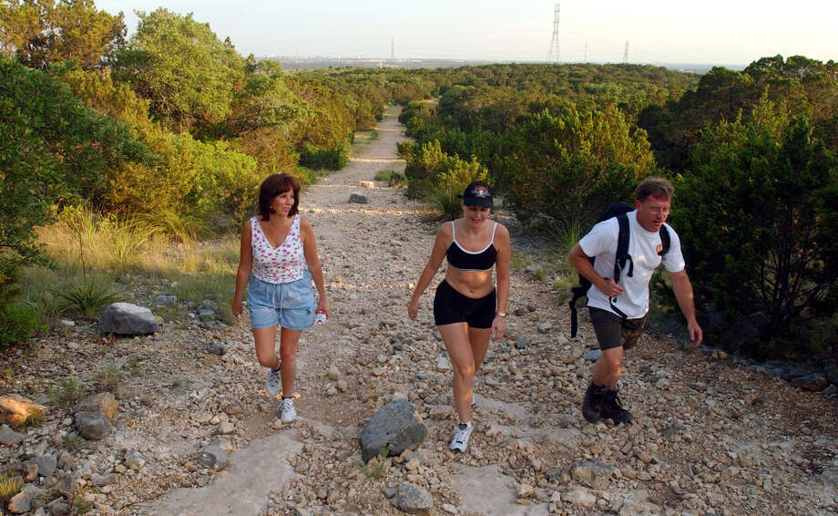 Eisenhower Park: The .4-mile Yucca Paved Trail is fairly level and appropriate for young children. For energetic children ages 5 and up, the paved Cedar Flats Trail goes uphill to the observation tower and on to the Shady Creek and Hillview Natural trails, which are rockier and not stroller-friendly.PHOTO: Adventure Club San Antonio members Michele Bosse (from left), Denise Conley-Friedman and Dirk Davidek hike up a trail in Eisenhower Park on May 20, 2002. Photo: Edward A. Ornelas, San Antonio Express-News / SAN ANTONIO EXPRESS-NEWS