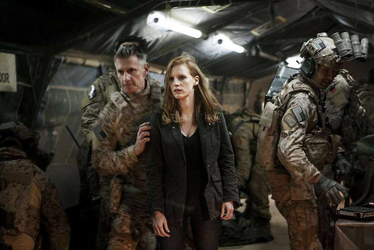 Stationed in a covert base overseas, Jessica Chastain (center) plays a member of the elite team of spies and military operatives (Christopher Stanley, LEFT and Alex Corbet Burcher, RIGHT) who secretly devoted themselves to finding Osama Bin Laden in Columbia Pictures' electrifying new thriller directed by Kathryn Bigelow, ZERO DARK THIRTY.