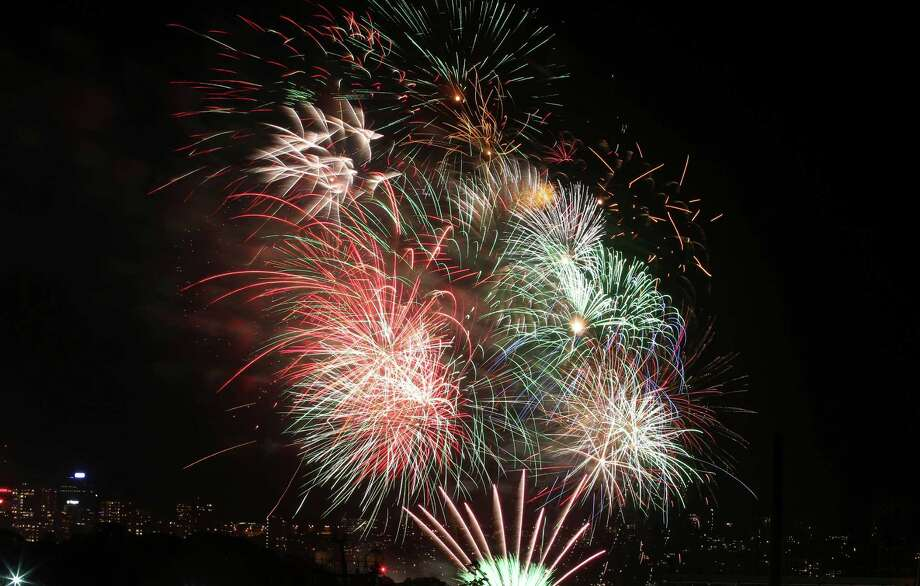 Fireworks explode in the sky above Sydney Harbour during the New Years Eve celebrations in Sydney, Australia. Photo: AP
