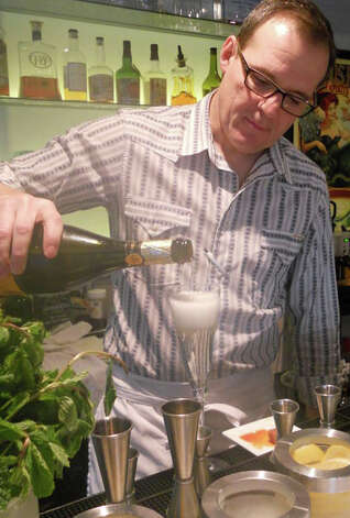 Robert Reilly, owner of Luxe Modern Wine and Cocktails in Westport, concocts a sparkling drink designed to appeal to those who don't like Champagne. Photo: Patti Woods / Fairfield Citizen contributed