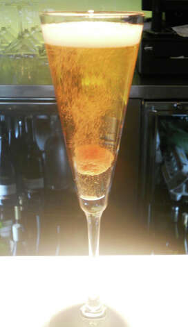 A Champagne cocktail or a Bellini are a way to serve New Year's guests a sparkling drink that's distinctive from Champagne itself. Photo: Patti Woods / Fairfield Citizen contributed