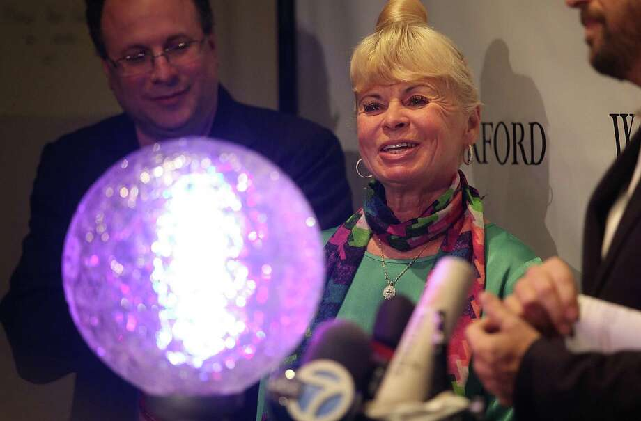 NEW YORK, NY - DECEMBER 27:  Kari Clark, wife of deceased longtime New Year's Eve host Dick Clark, smiles before helping install new Waterford Crystal triangles for the Times Square New Years Eve Ball at a media event on December 27, 2012 in New York City. The ball will once again descend a 141-foot tall flagpole to mark the beginning of 2013. Photo: Mario Tama, Getty Images / 2012 Getty Images