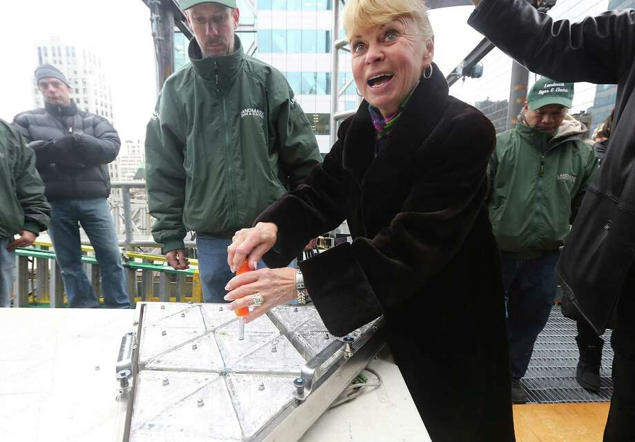 NEW YORK, NY - DECEMBER 27:  Kari Clark, wife of deceased longtime New Year's Eve host Dick Clark, poses while helping install new Waterford Crystal triangles for the Times Square New Years Eve Ball at a media event on December 27, 2012 in New York City. The ball will once again descend a 141-foot tall flagpole to mark the beginning of 2013. Photo: Mario Tama, Getty Images / 2012 Getty Images