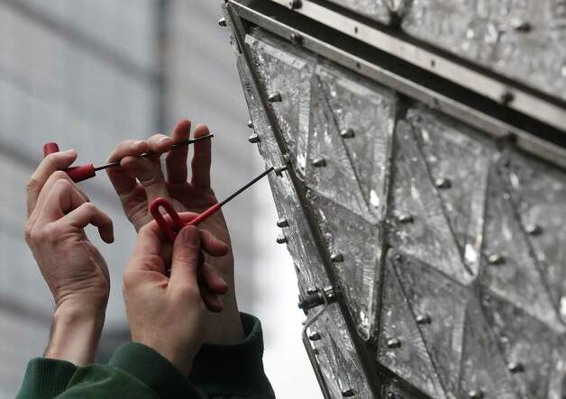 NEW YORK, NY - DECEMBER 27:  Workers install new Waterford Crystal triangles on the Times Square New Years Eve Ball at a media event on December 27, 2012 in New York City. The ball will once again descend a 141-foot tall flagpole to mark the beginning of 2013.  (Photo by Mario Tama/Getty Images)  *** BESTPIX *** Photo: Mario Tama, Getty Images / 2012 Getty Images