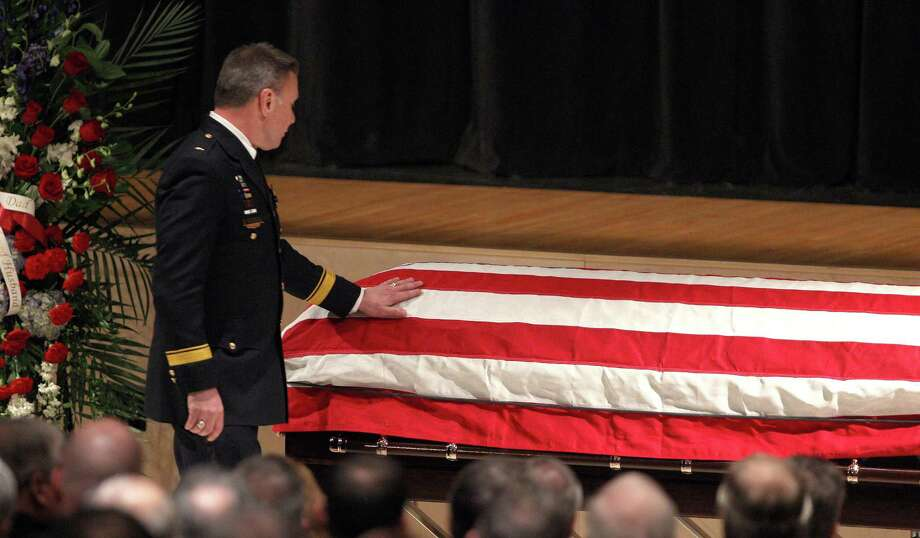 Webster Police Chief Gerald Pickering at the casket of  firefighter and Webster police officer Michael Chiapperini during his funeral service, Sunday Dec. 30, 2012 at Webster Schroeder High School in Webster, N.Y. Thousands of mourners, including firefighters from across the United States and Canada payed their final respects to West Webster Fire Fighter, Lt. Michael Chiapperini. Chiapperini and firefighter, Tomasz Kaczowka, were both shot and killed while on duty Dec. 24, 2012 in Webster, N.Y. Photo: Jamie Germano, AP / POOL Democrat & Chronicle