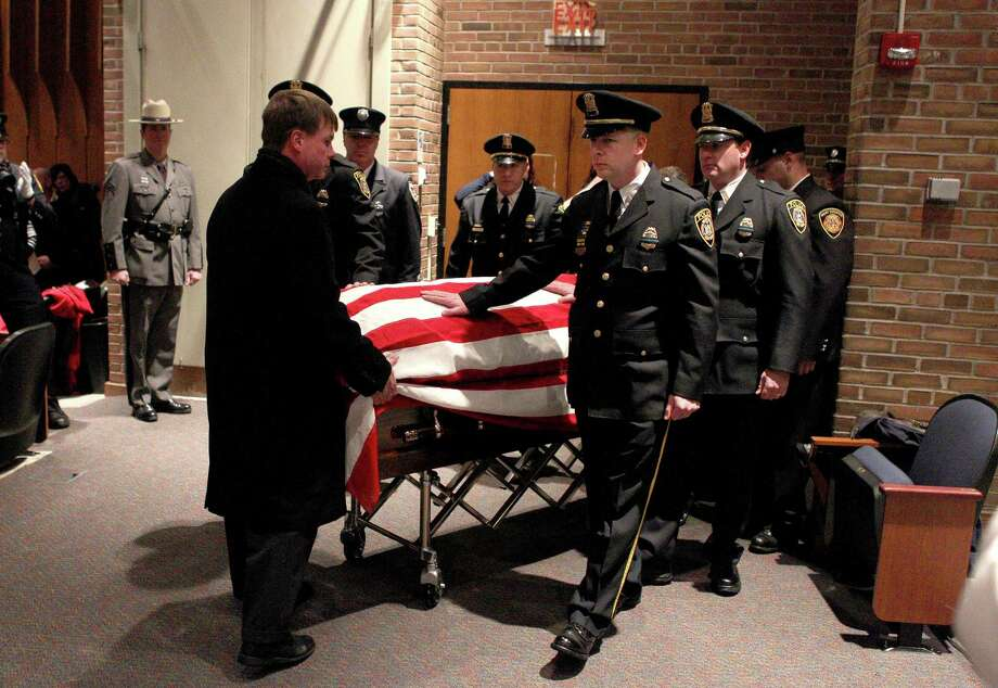West Webster Fire District bring in the casket of firefighter Michael Chiapperini during his funeral service, Sunday Dec. 30, 2012 at Webster Schroeder High School in Webster, N.Y. Thousands of mourners, including firefighters from across the United States and Canada payed their final respects to West Webster Fire Fighter, Lt. Michael Chiapperini. Chiapperini and firefighter, Tomasz Kaczowka, were both shot and killed while on duty Dec. 24, 2012 in Webster, N.Y. Photo: Jamie Germano, AP / POOL Democrat & Chronicle