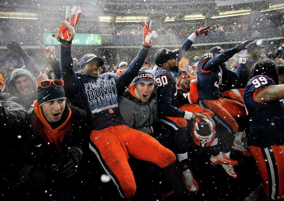 NEW YORK, NY - DECEMBER 29:  Members of the Syracuse Orange celebrate with fans after their win over the West Virginia Mountaineers in the New Era Pinstripe Bowl at Yankee Stadium on December 29, 2012 in the Bronx borough of New York City.  (Photo by Jeff Zelevansky/Getty Images) ***BESTPIX*** Photo: Jeff Zelevansky, Getty Images / 2012 Getty Images