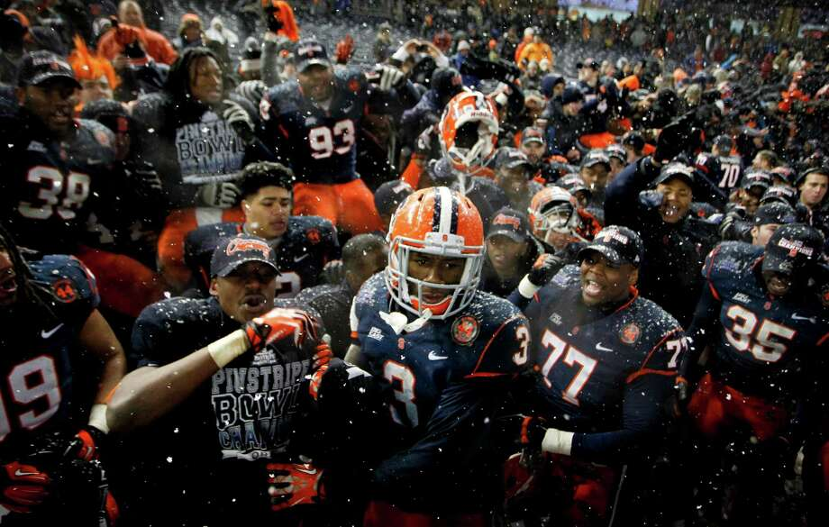 NEW YORK, NY - DECEMBER 29:  Members of the Syracuse Orange celebrate with fans after their win over the West Virginia Mountaineers in the New Era Pinstripe Bowl at Yankee Stadium on December 29, 2012 in the Bronx borough of New York City. Photo: Jeff Zelevansky, Getty Images / 2012 Getty Images