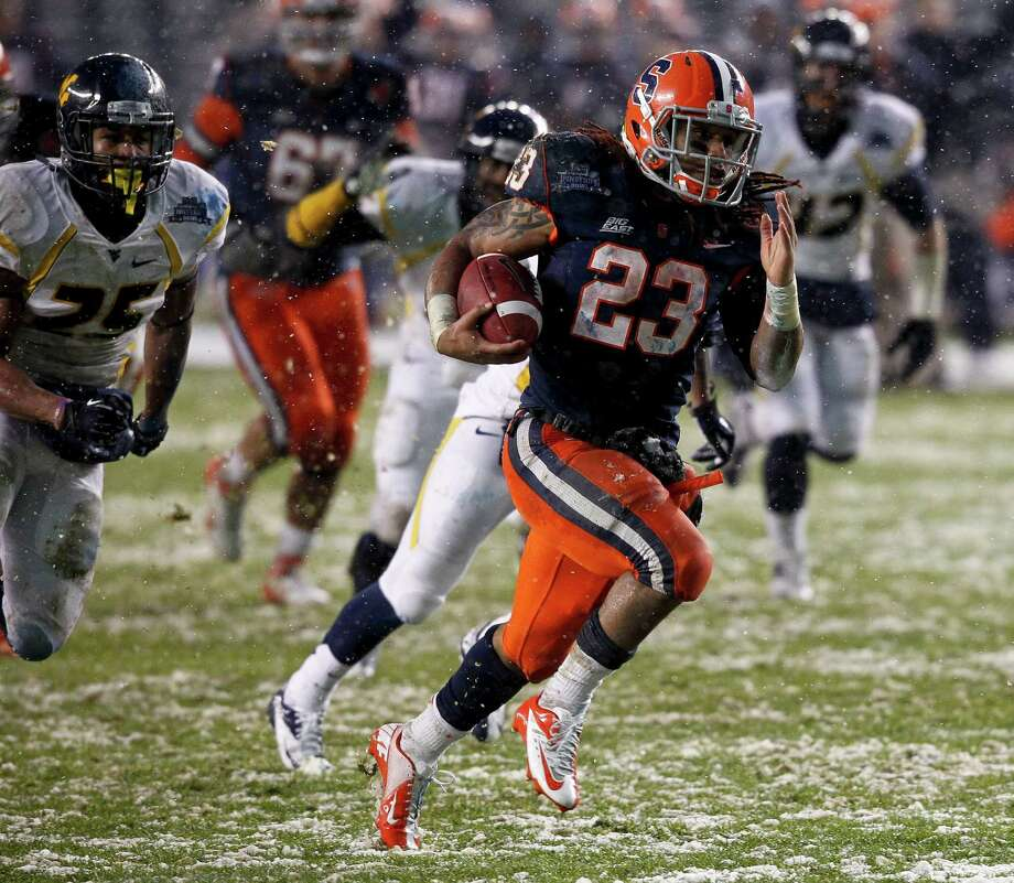 NEW YORK, NY - DECEMBER 29:  Prince-Tyson Gulley #23 of the Syracuse Orange runs for a touchdown against the West Virginia Mountaineers in the New Era Pinstripe Bowl at Yankee Stadium on December 29, 2012 in the Bronx borough of New York City. Photo: Jeff Zelevansky, Getty Images / 2012 Getty Images