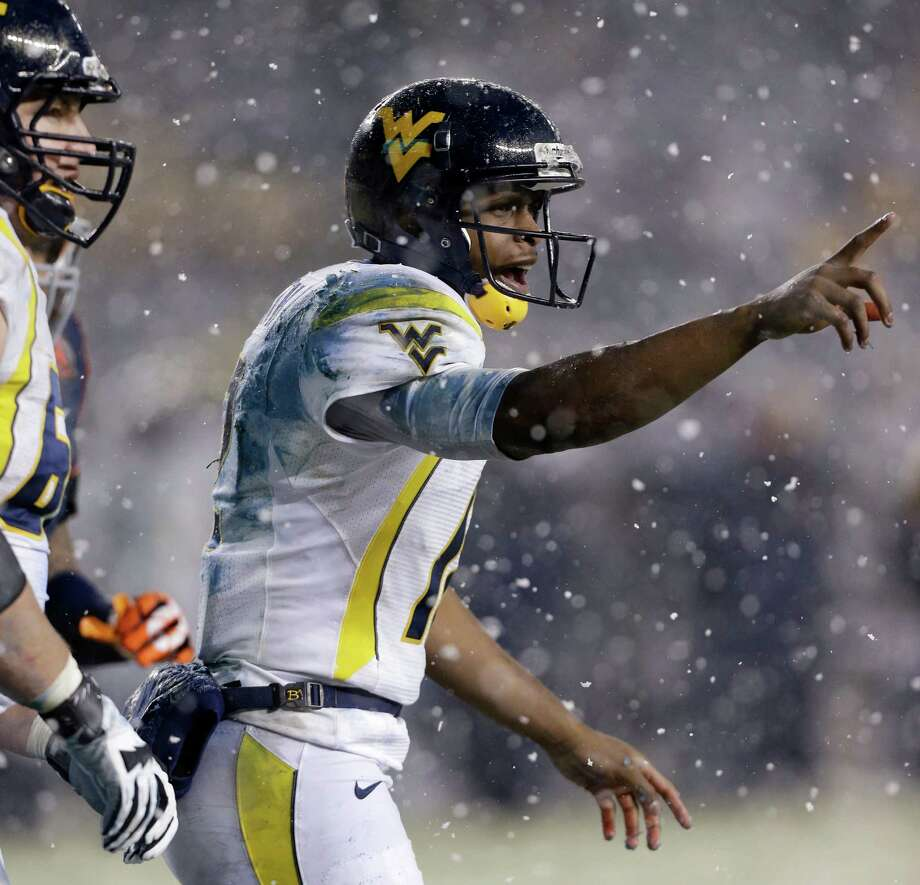 West Virginia quarterback Geno Smith reacts after Syracuse defenders dragged him down in the end zone for a safety during the second half of the Pinstripe Bowl NCAA college football game at Yankee Stadium in New York, Saturday, Dec. 29, 2012. Syracuse won 38-14. Photo: Kathy Willens, AP / AP