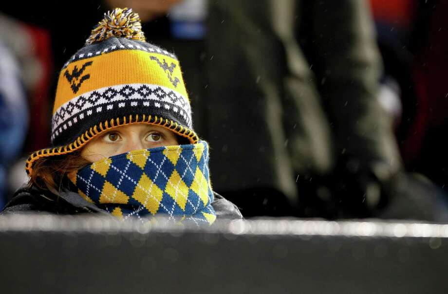 NEW YORK, NY - DECEMBER 29:  A West Virginia Mountaineers fan watches as they face the Syracuse Orangein the New Era Pinstripe Bowl at Yankee Stadium on December 29, 2012 in the Bronx borough of New York City. Photo: Jeff Zelevansky, Getty Images / 2012 Getty Images